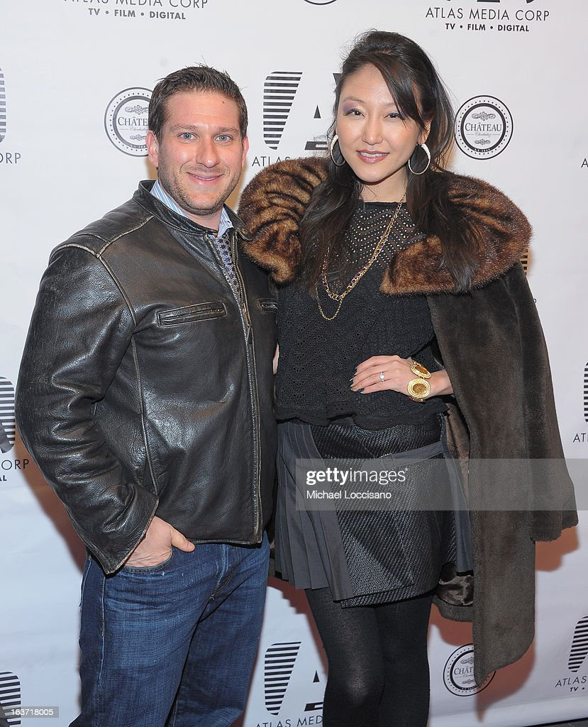 Castmember Michael Ferraro and Michelle Park attend the 'Playing With Fire' premiere at Chateau Cherbuliez on March 14, 2013 in New York City.