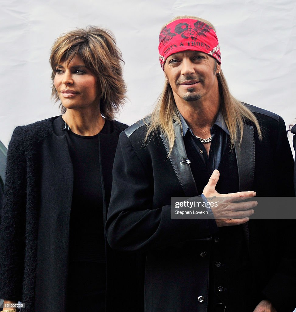 Castmembers actress <a gi-track='captionPersonalityLinkClicked' href=/galleries/search?phrase=Lisa+Rinna&family=editorial&specificpeople=202100 ng-click='$event.stopPropagation()'>Lisa Rinna</a> and singer/TV personality Brett Michaels attend the 'Celebrity Apprentice All Stars' Season 13 Bus Tour at on October 12, 2012 in New York City.
