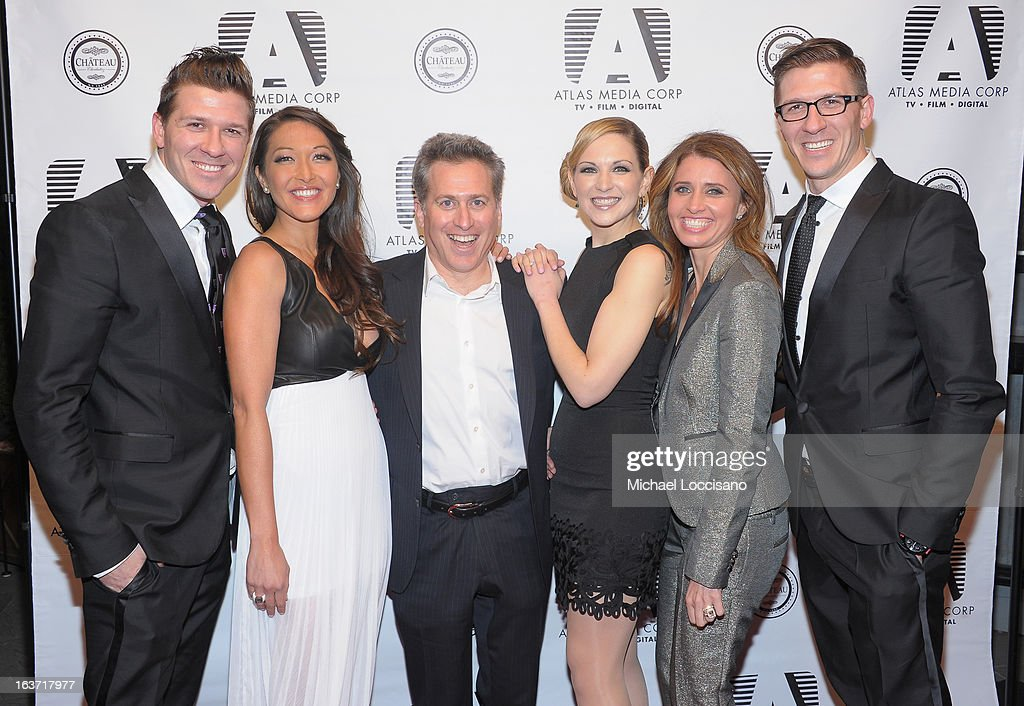 Castmembers Daniel Koch and Candice Kumai, Executive Producer Bruce David Klein, and castmembers Julie Elkind, Anna Boiardi and Derek Koch attend the 'Playing With Fire' premiere at Chateau Cherbuliez on March 14, 2013 in New York City.