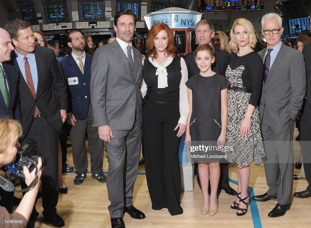 Castmembers of 'Mad Men' Jon Hamm, Christina Hendricks, Kiernan Shipka, January Jones and John Slattery pose after ringing the opening bell at the New York Stock Exchange on March 21, 2012 in New York City.