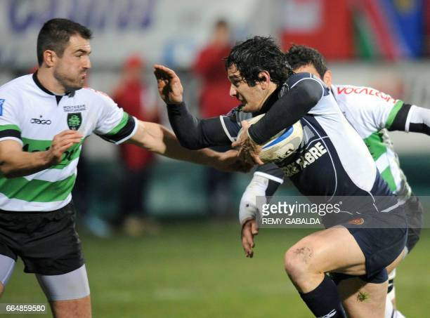 Castres' center Romain Cabannes vies with Montauban's fullback Johan Dalla Riva during their French Top 14 Rugby Union match Castres vs Montauban on...