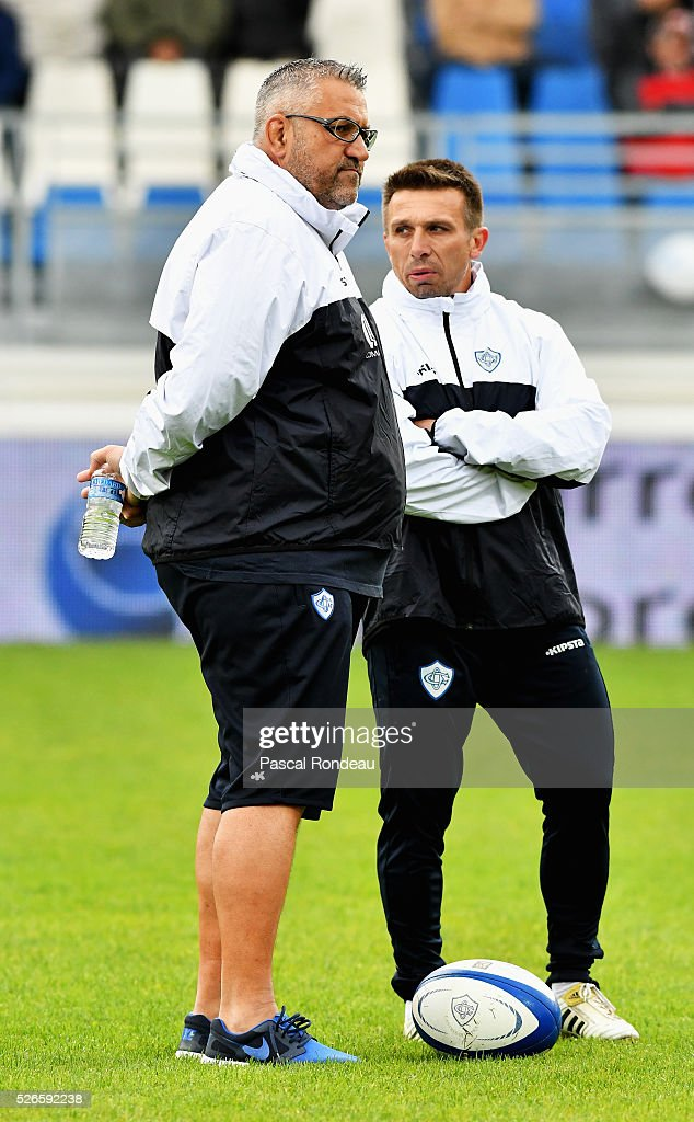 Castres coach Christophe Urios and Romain Teulet from Castres during the French Top 14 rugby union match between Castre v Pau on April 30, 2016 in Castres, France.