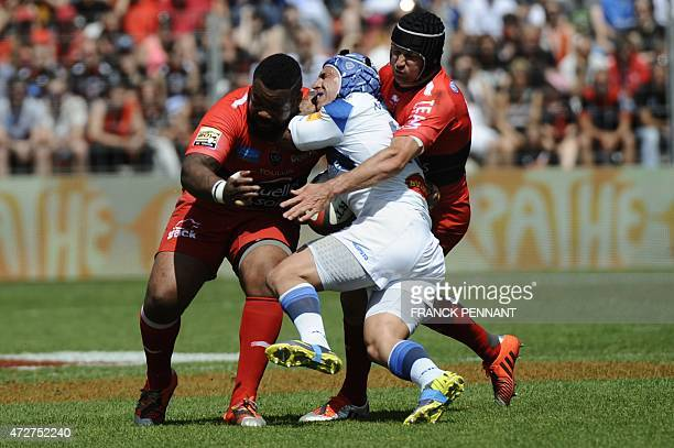 Castres flyhalf Dan Kirkpatrick vies RC Toulon's players during the French Top 14 rugby union match between RC Toulon and Castres on May 09 2015 at...