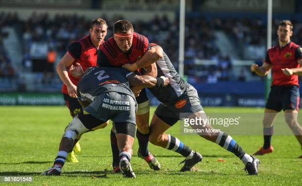 Castres France 15 October 2017 CJ Stander of Munster is tackled by Jody Jenneker and Yannick Caballero of Castres Olympique during the European Rugby...