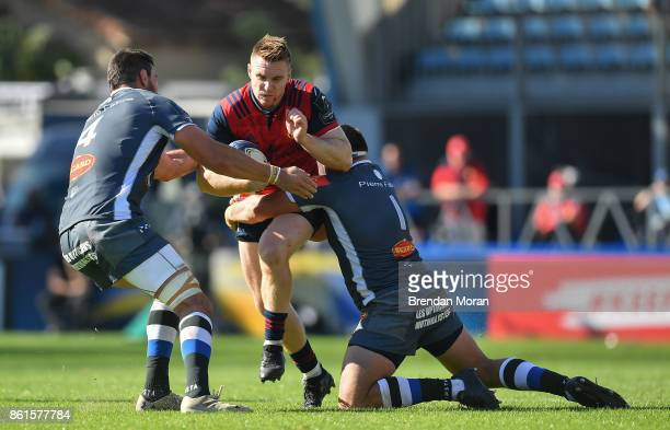 Castres France 15 October 2017 Rory Scannell of Munster is tackled by Loic Jacquet left and Antoine Tichit of Castres Olympique during the European...