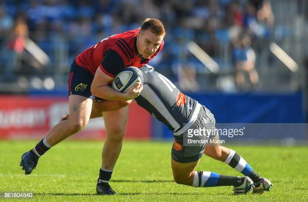 Castres France 15 October 2017 Rory Scannell of Munster is tackled by Benjamin Urdapilleta of Castres Olympique during the European Rugby Champions...