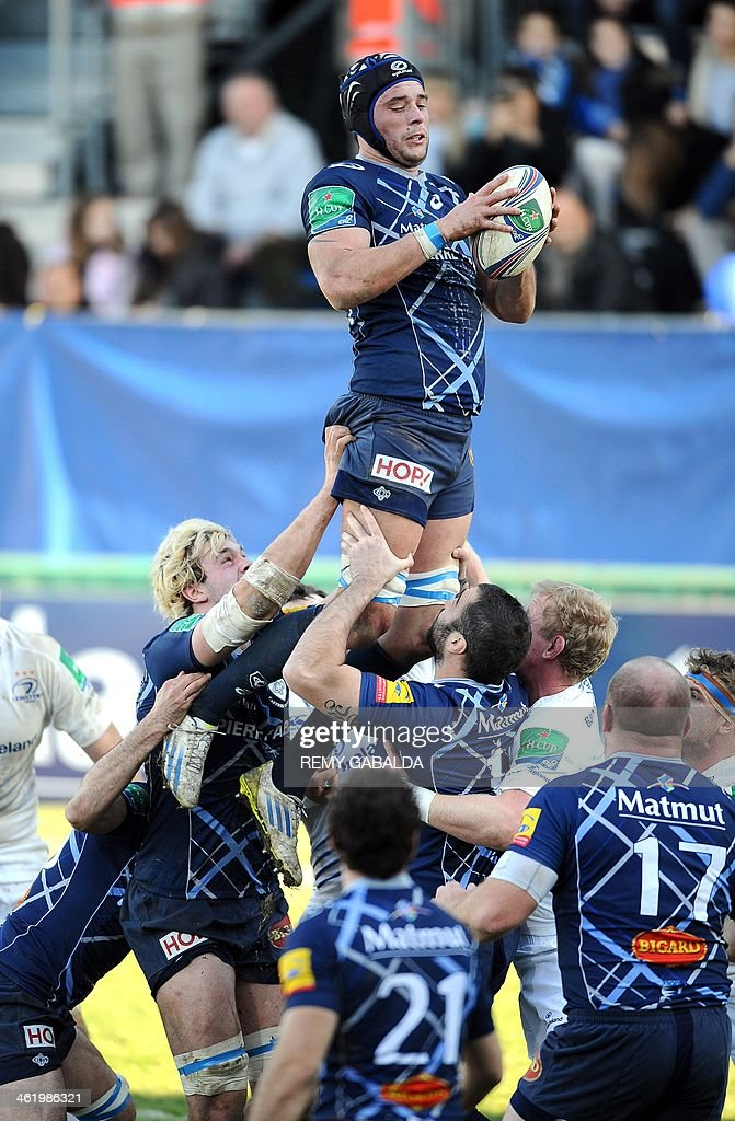 Castres France  City new picture : Castres' French lock Christophe Samson C grabs the ball in a line ...