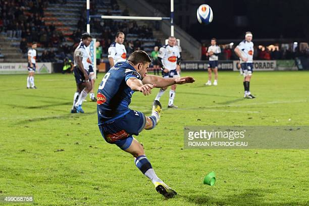 Castre's French scrum half Rory Kockott shoots a penalty during the French Top 14 rugby union match between Agen and Castres on November 28 2015 at...