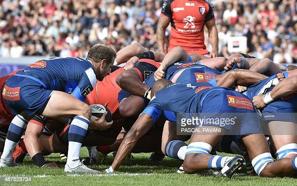 Castres French scrumhalf Julien Seron and Castres pack during the French Top 14 rugby union match Toulouse against Castres on September 5 2015 at the...
