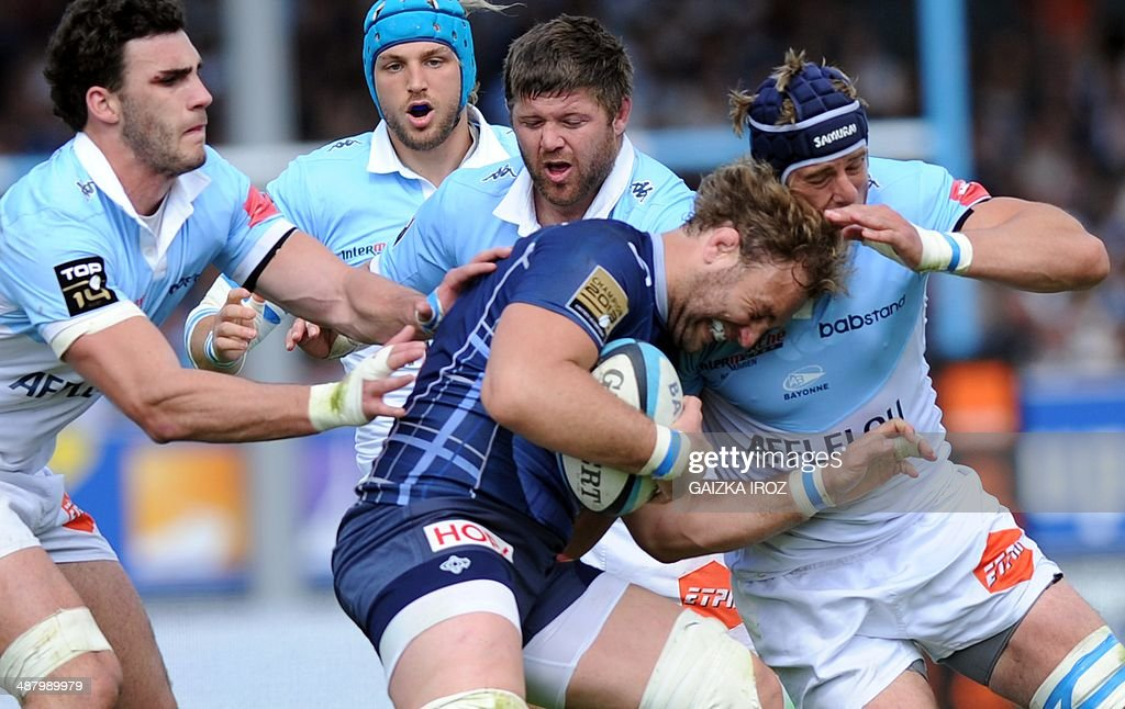 Castres' number eight Antonie Claassen vies with Bayonne's players during the French Top 14 rugby Union match between Bayonne and Castres on May 3 at...