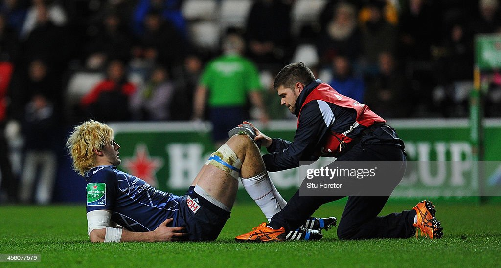 Castres player <a gi-track='captionPersonalityLinkClicked' href=/galleries/search?phrase=Richie+Gray+-+Rugby+Player&family=editorial&specificpeople=5907993 ng-click='$event.stopPropagation()'>Richie Gray</a> receives treatment to an injury that leads to him leaving the game early during the Heineken Cup pool 1 round 4 match between Ospreys and Castres Olympique at Liberty Stadium on December 13, 2013 in Swansea, Wales.