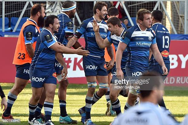 Castres' players celebrate during the European Champions Cup rugby union match between Castres and Montpellier on December 18 2016 at the Pierre...