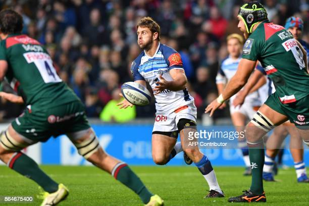 Castres' South African scrumhalf Rory Kockott passes the ball during the European Champions Cup Pool 4 rugby union match between Leicester Tigers and...