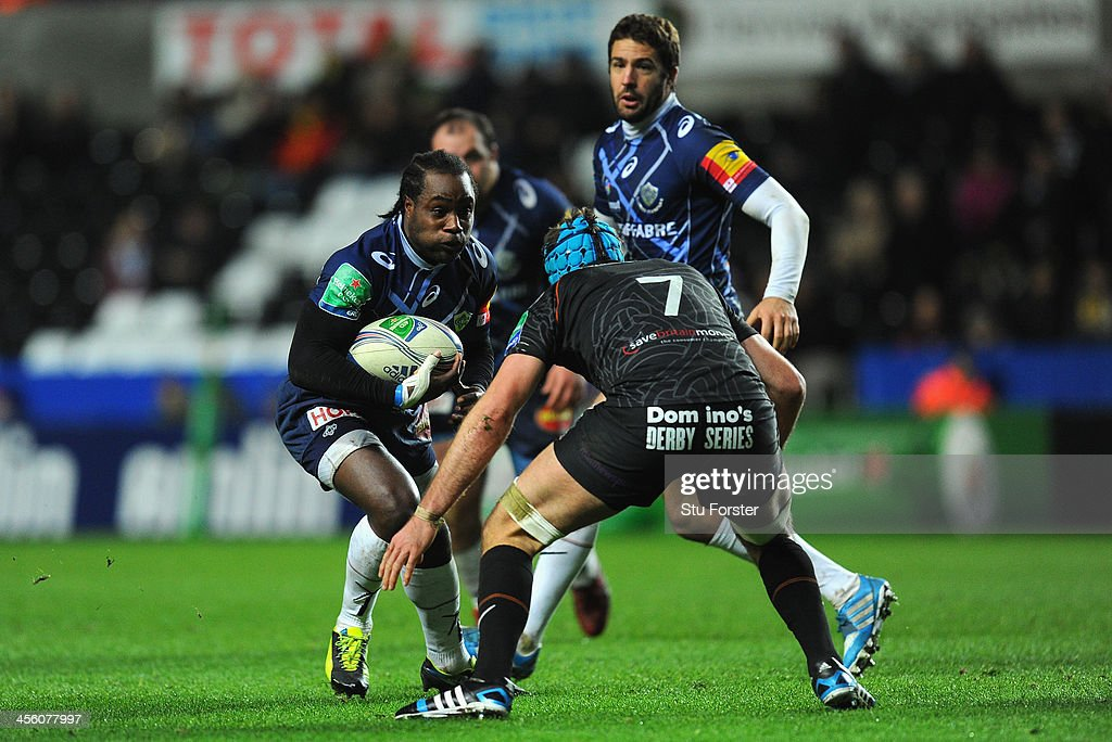 Castres wing <a gi-track='captionPersonalityLinkClicked' href=/galleries/search?phrase=Marcel+Garvey&family=editorial&specificpeople=226829 ng-click='$event.stopPropagation()'>Marcel Garvey</a> runs into Justin Tipuric (7) during the Heineken Cup pool 1 round 4 match between Ospreys and Castres Olympique at Liberty Stadium on December 13, 2013 in Swansea, Wales.