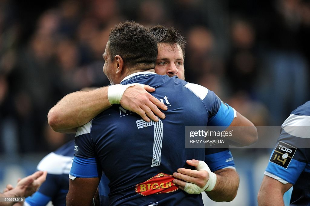 Castres's captain Rodrigo Ortega (R) celebrates with Mathieu Babilot (L) after the team's second try during the French Top 14 Rugby Union match Castres vs Pau at the Pierre Antoine Stadium in Castres, southern France on April 30, 2016.