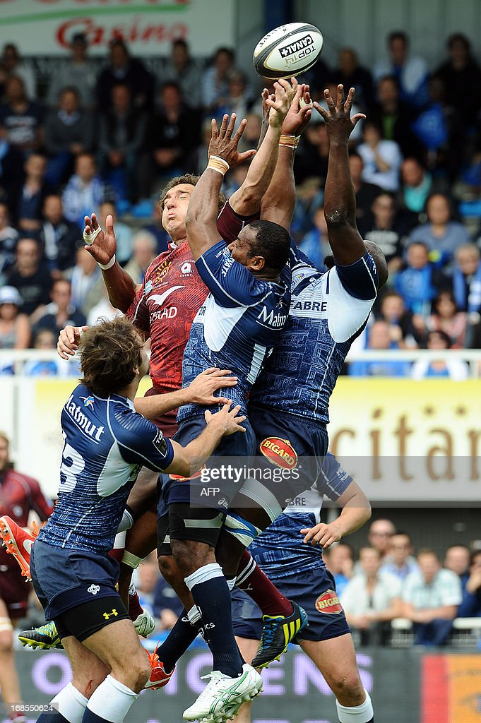 Castres's Fijian flanker Seremaia Bai (C) grabs an aerial ball during the French Top 14 rugby union match Castres vs Montpellier on May 11, 2013 at the Pierre Antoine Stadium in Castres, southern France. AFP PHOTO / REMY GABALDA