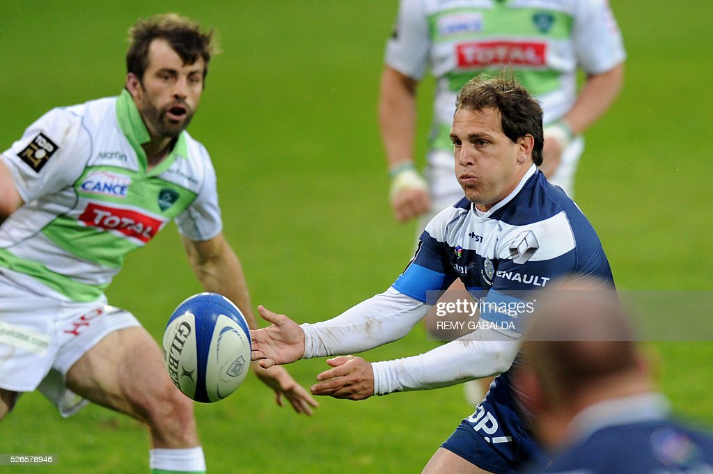 Castres's fly half Benjamin Urdapilleta passes the ball during the French Top 14 Rugby Union match Castres vs Pau at the Pierre Antoine Stadium in Castres, southern France on April 30, 2016.