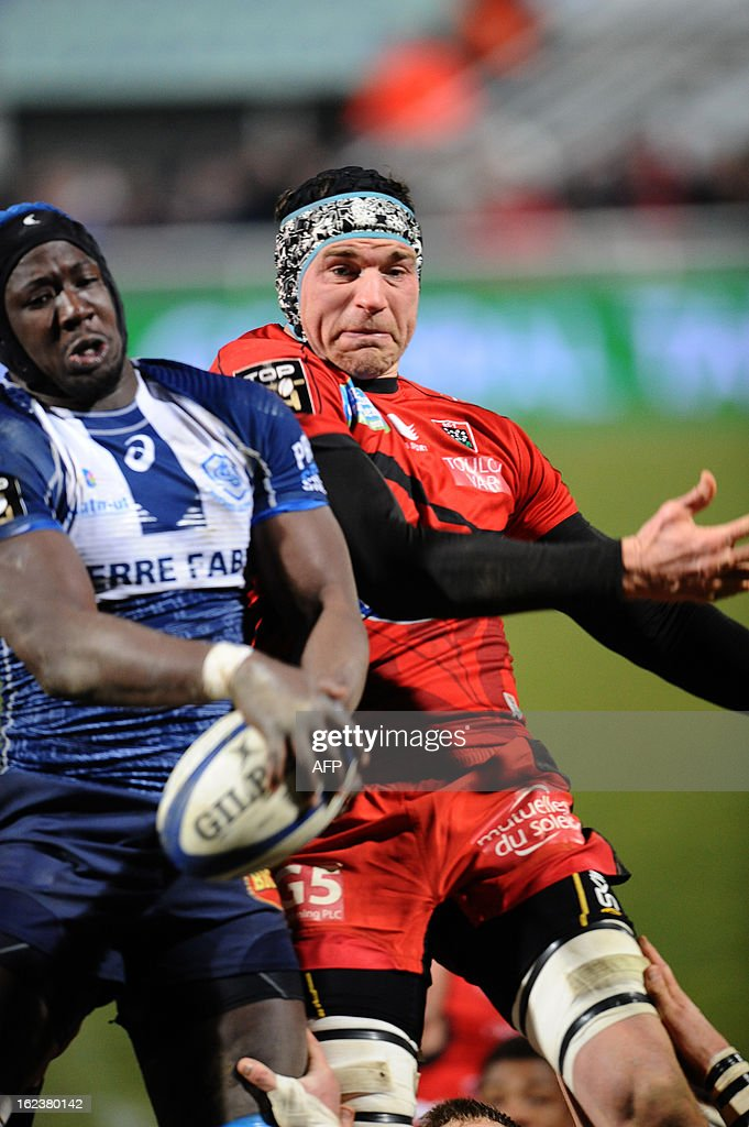 Castres's Ibrhaim Diarra (L) grabs the ball in a line out next to Toulon's lock Nicholas Kennedy (R) during this top 14 rugby matche Castres vs Toulon RC at the Pierre Antoine Stadium in Castres on February 22, 2013.