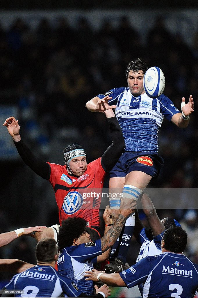 Castres's Mathias Roland (R) grabs the ball in a line out next to Toulon's lock Nicolas Kennedy (L) during a top 14 rugby match Castres vs Toulon RC at the Pierre Antoine Stadium in Castres, on February 22, 2013.