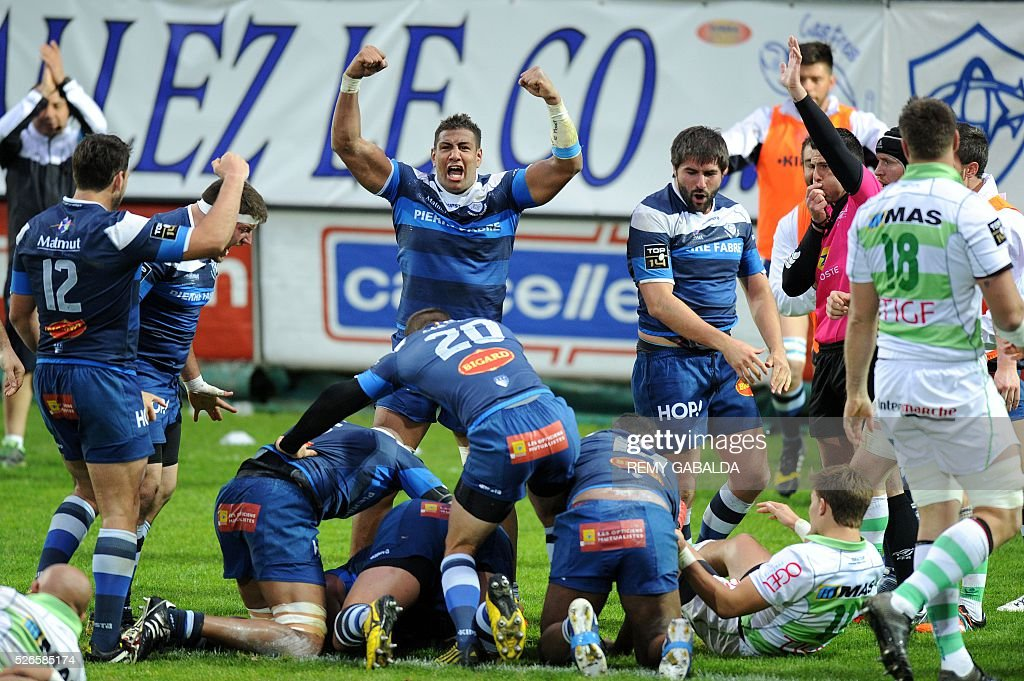 Castres's players celebrate after prop Karena Wihongi scored a try during the French Top 14 Rugby Union match Castres vs Pau at the Pierre Antoine Stadium in Castres, southern France on April 30, 2016.