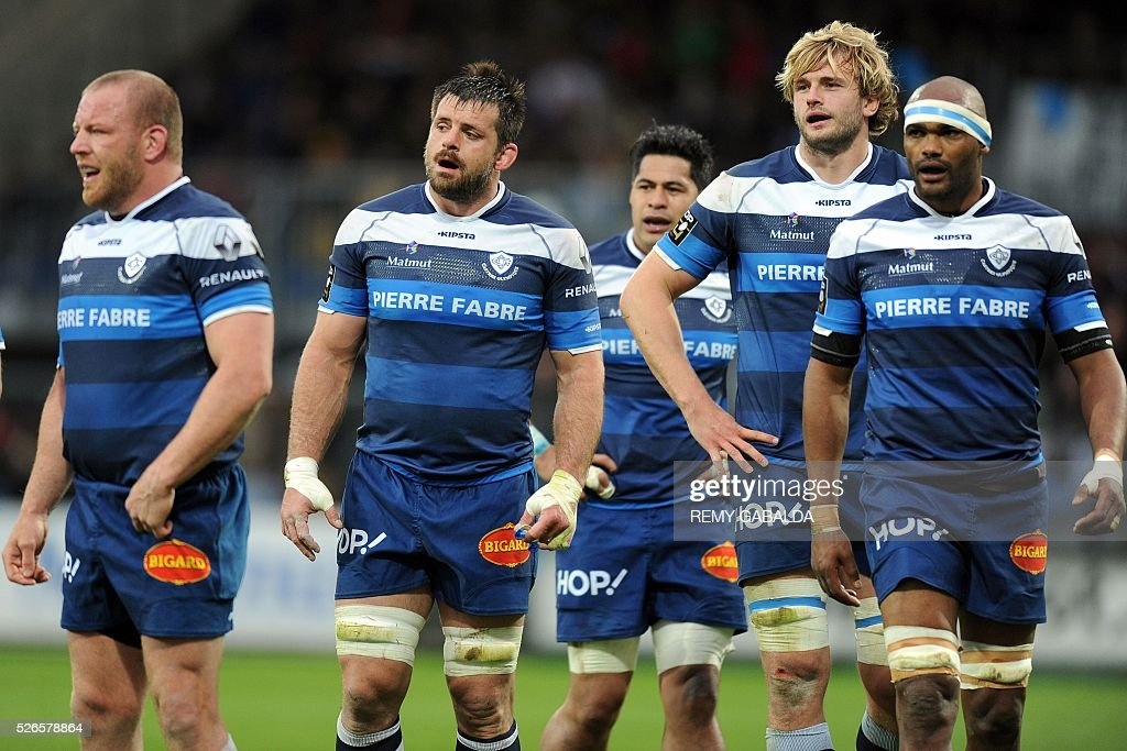 Castres's players react during the French Top 14 Rugby Union match Castres vs Pau at the Pierre Antoine Stadium in Castres, southern France on April 30, 2016.