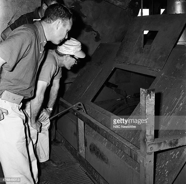 WIDE 60 'Castro's Year of Power' Episode 101 Pictured NBC New's WIlson D Hall Frank McGee at Nicaro Nickel Mine in Oriente Province during a news...