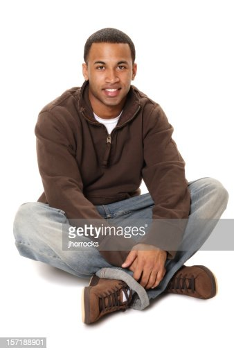 Casual African American Male Sitting Cross-legged on Floor
