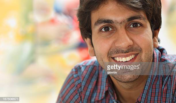 Casual and confidant young man smiling