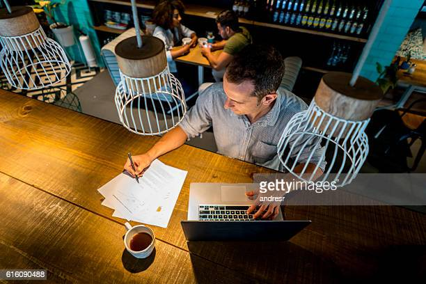 Casual business man working at a cafe