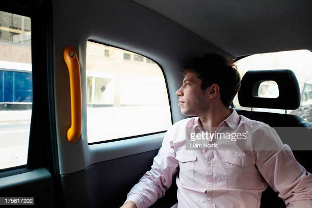 Casual businessman in black cab, London, England, UK