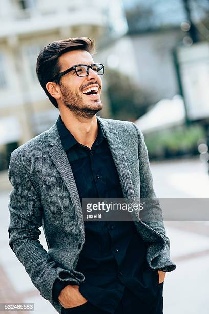 Casual businessman smiling outdoors