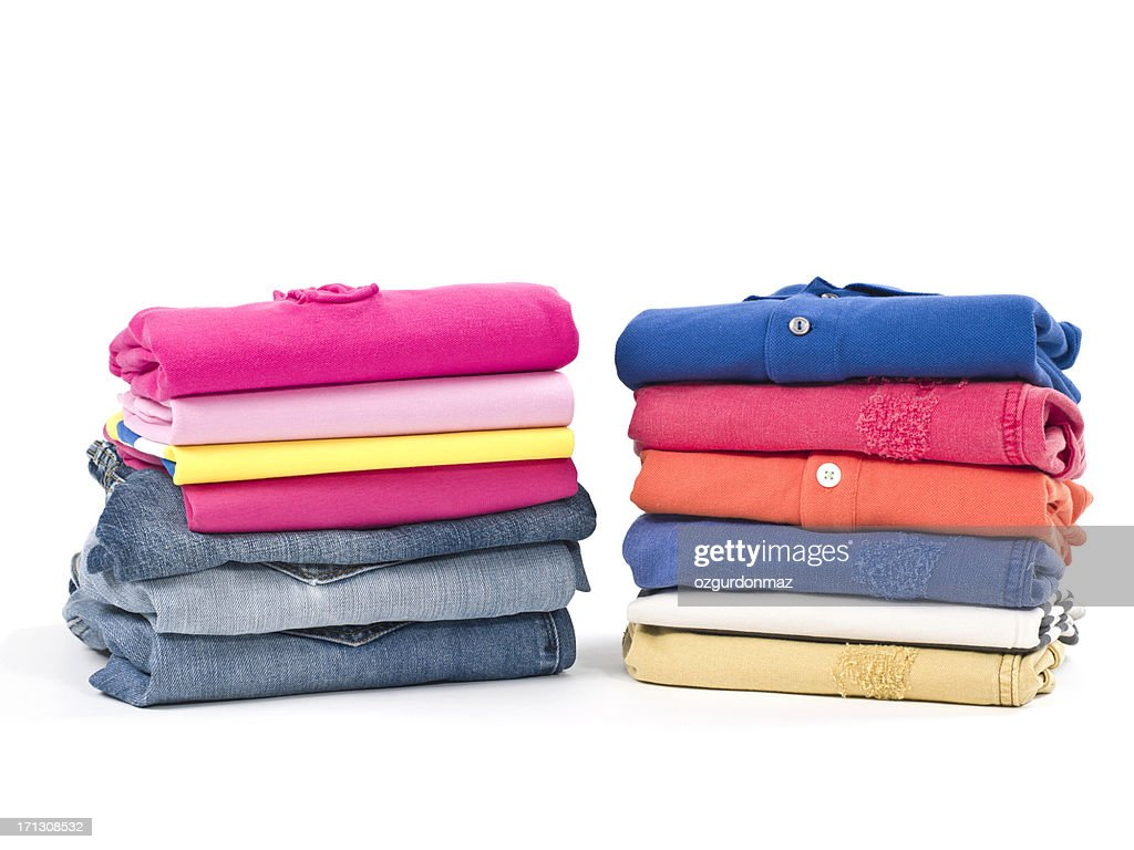 casual clothes folded in pile on white stock photo getty