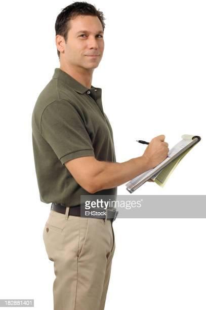 Robe décontractée Homme d'affaires écrit sur presse-papiers