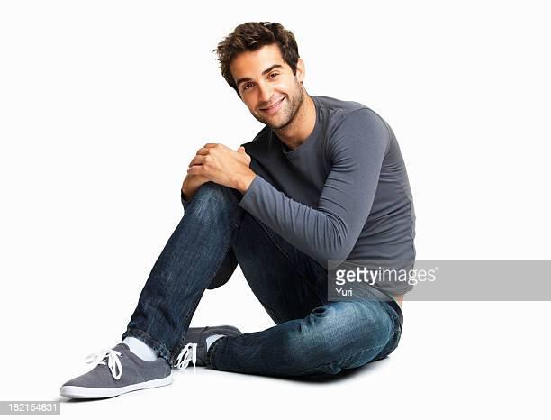 Casual homem Sentado no Chão