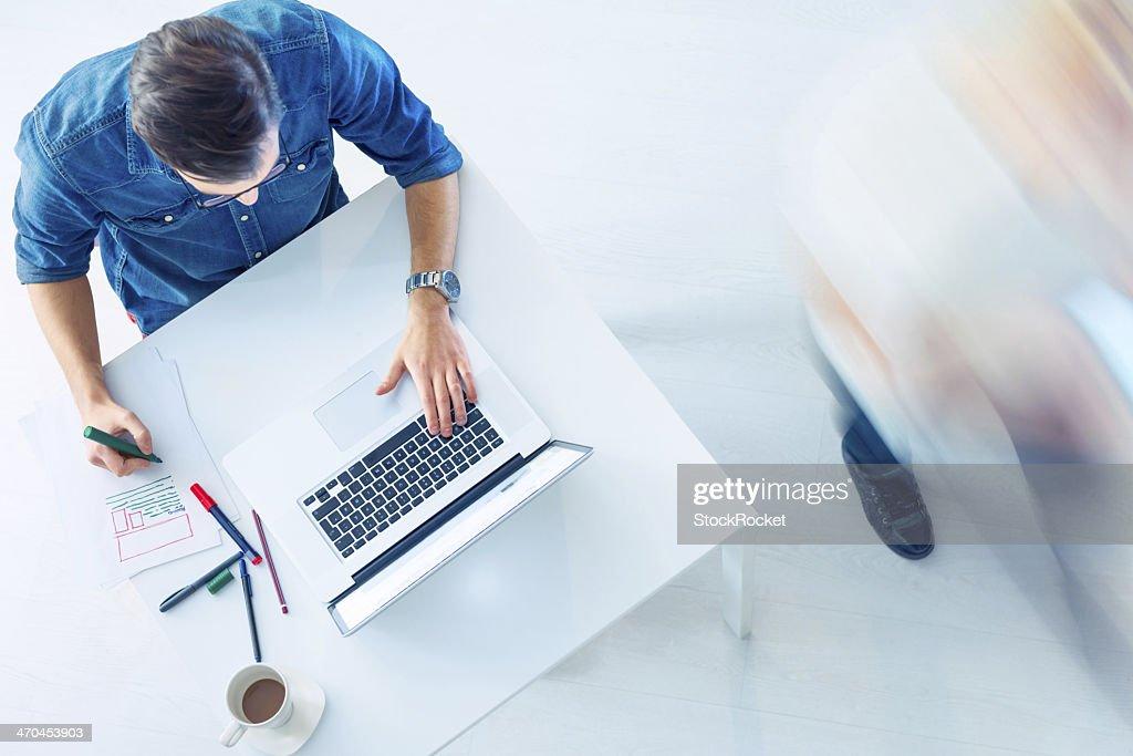 Casual Guy workin on laptop