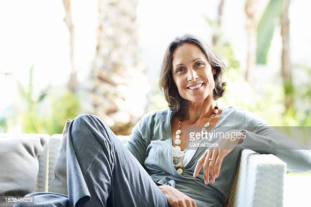 Casual, mature woman relaxing at home