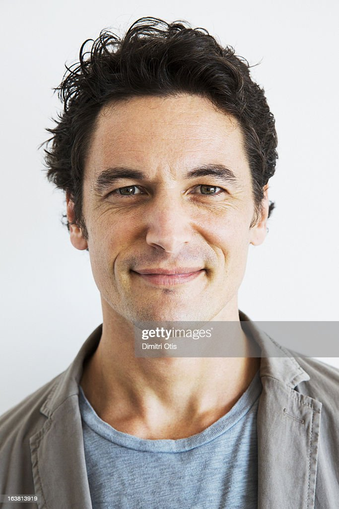 Casual portrait of relaxed man, smiling : Stock Photo
