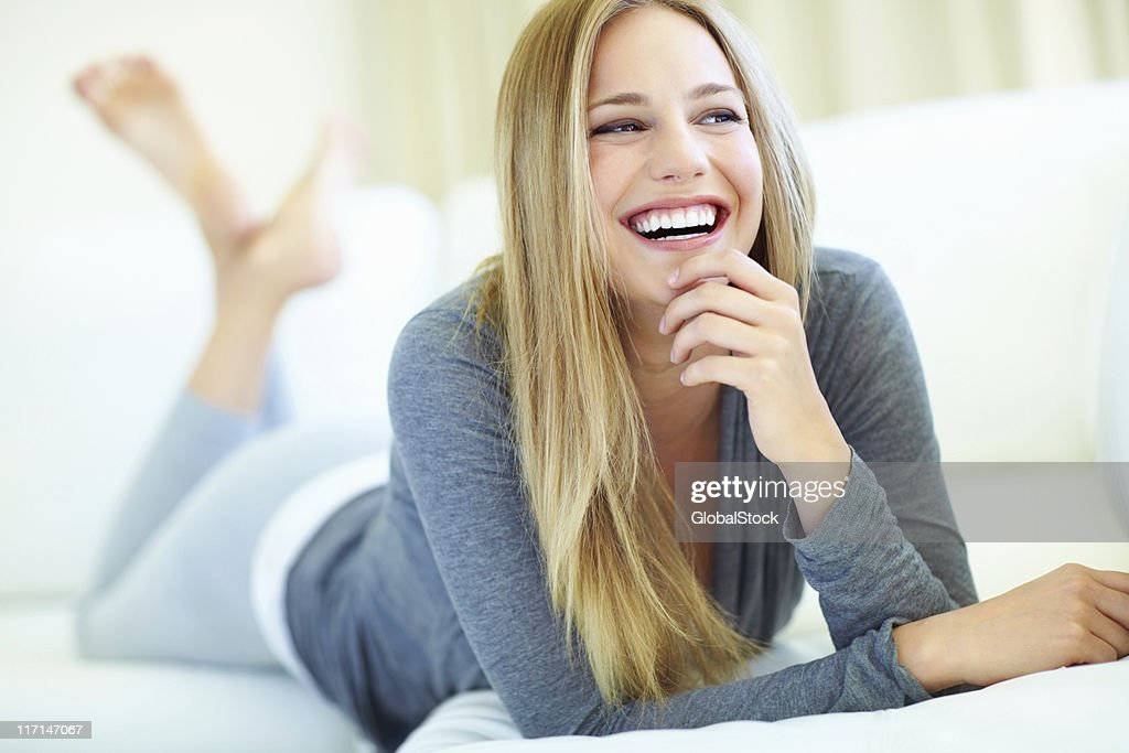 Casual, relaxed woman laughing : Stock Photo