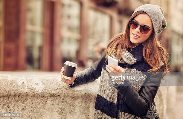Casual woman looking at mobile phone