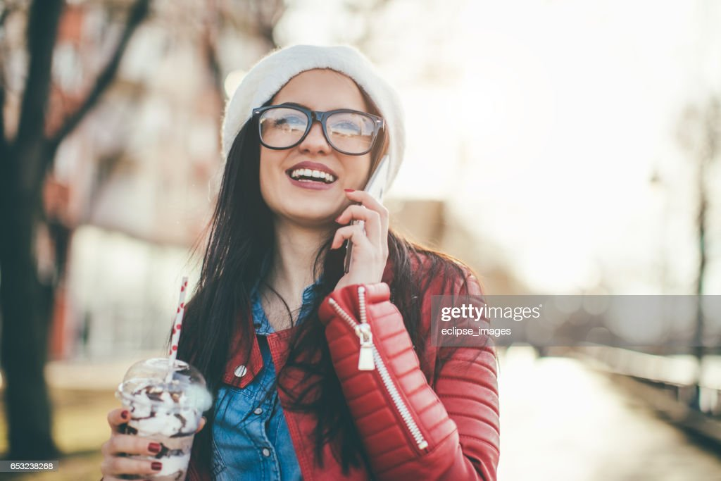 Casual woman looking at mobile phone : Stock Photo