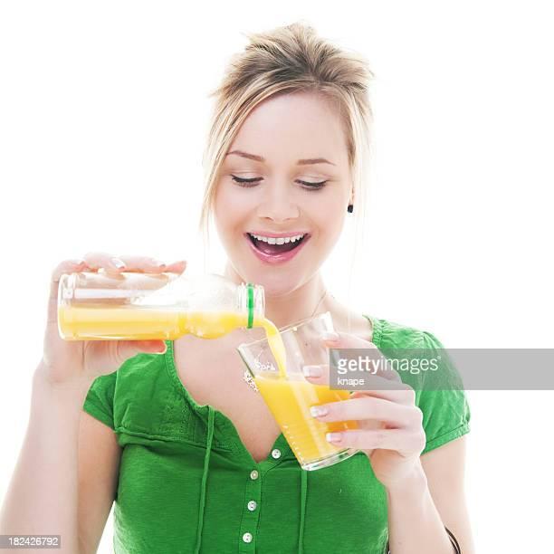 Casual woman pouring orange juice