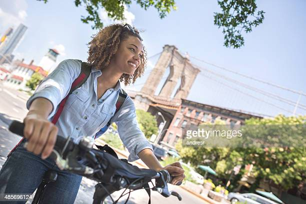 Casual woman riding a bike in the city
