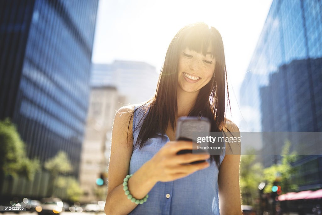 casual woman text messaging in montreal - urban scene