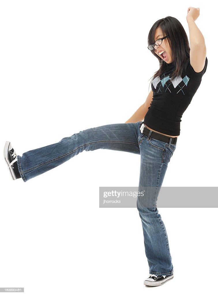 Casual Young Asian Woman Kicking