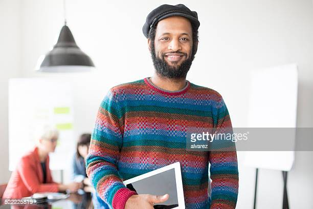 Casual young man with digital tablet