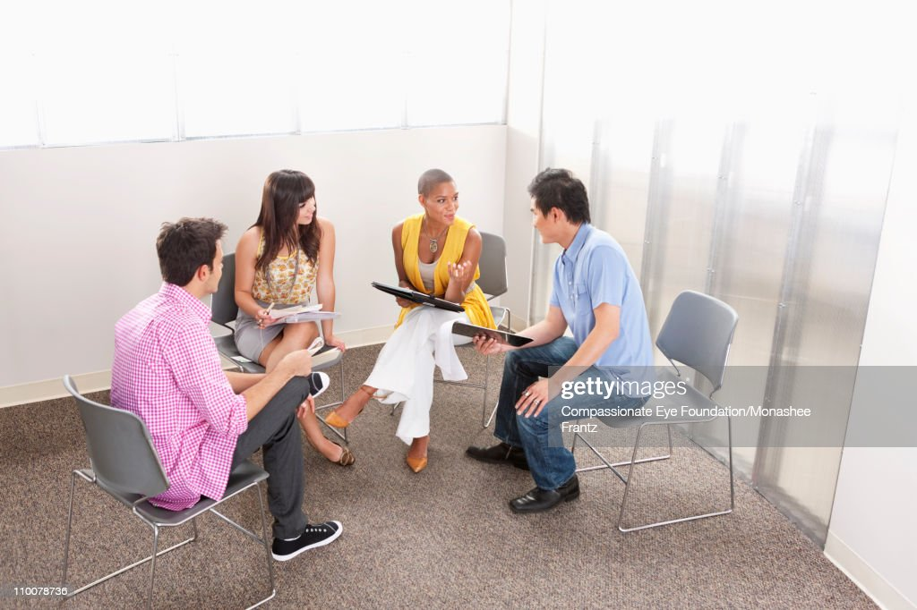 Casually dressed businesspeople having a meeting : Stock Photo