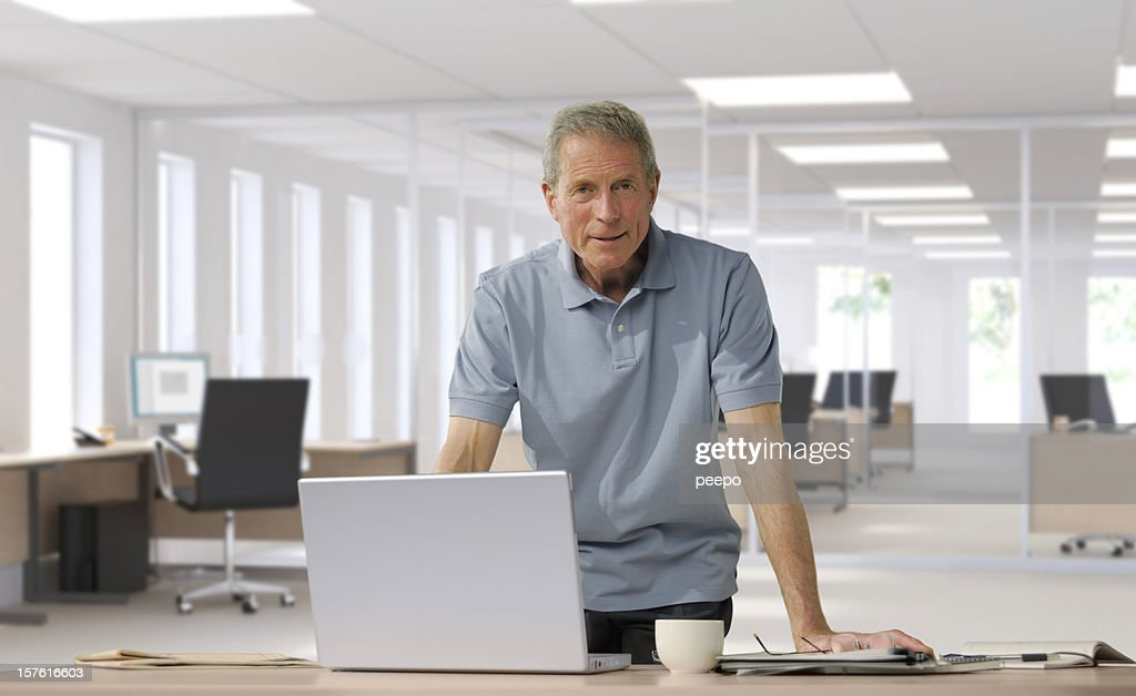 casually dressed mature businessman : Stock Photo