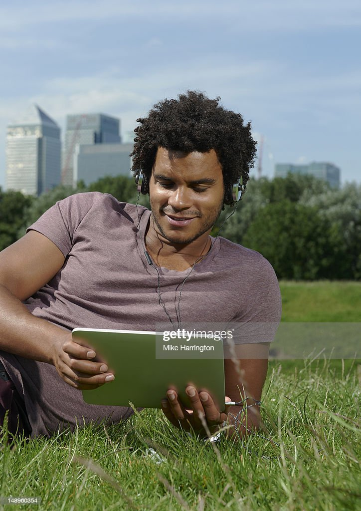 Casually Male Using Ipad in City Park : Stock Photo