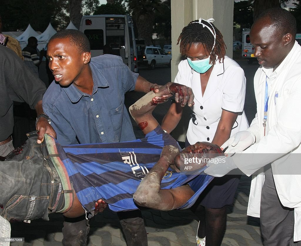 A casualty of a suspected bomb attack in Nairobi's Eastleigh suburb November 18, 2012 is carried by medics at Kenyatta National Hospital after seven people were killed and many more wounded when an apparent explosive device was hurled at a packed minibus in a predominantly Somali area of the Kenyan capital Nairobi, police and the Red Cross said. Nairobi police chief Moses Nyakwama said the blast occurred on a so-called 'matatu', or local minibus, in the district of Eastleigh, where mainly Somalis or Kenyans of Somali origin live and which has been the target of other attacks in recent weeks. AFP PHOTO/STRINGER