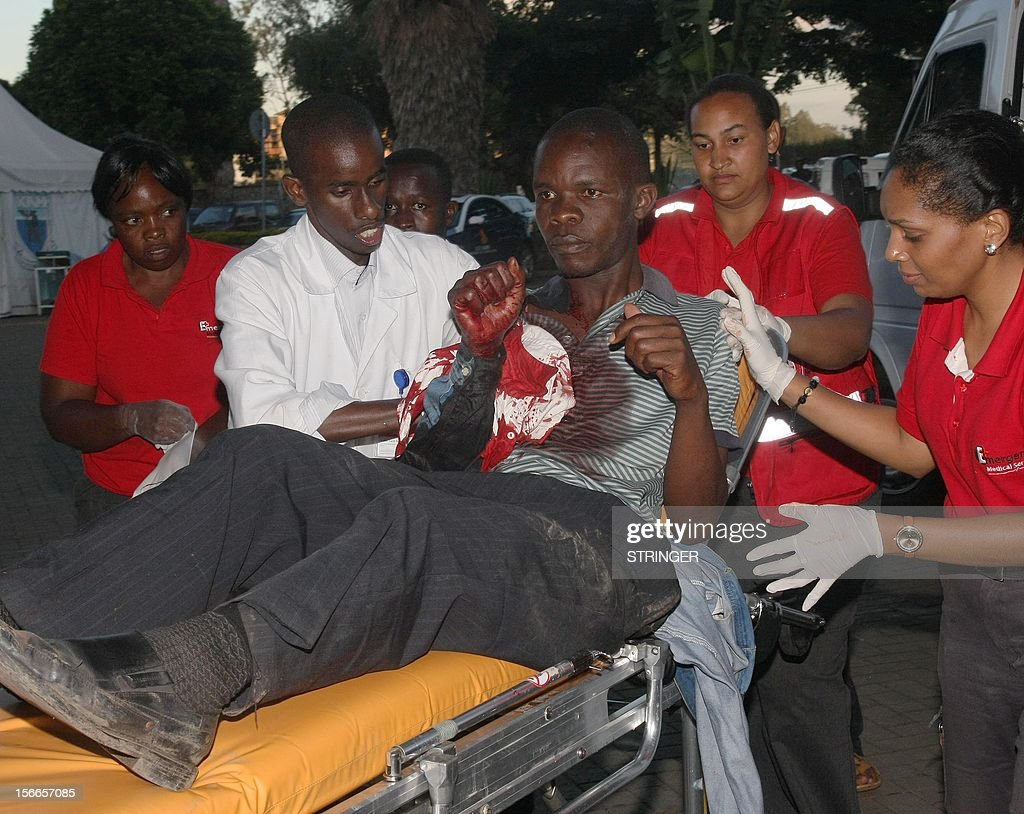 A casualty of a suspected bomb attack in Nairobi's Eastleigh suburb November 18, 2012 is carried on a stretcher at Kenyatta National Hospital after seven people were killed and many more wounded when an apparent explosive device was hurled at a packed minibus in a predominantly Somali area of the Kenyan capital Nairobi, police and the Red Cross said. Nairobi police chief Moses Nyakwama said the blast occurred on a so-called 'matatu', or local minibus, in the district of Eastleigh, where mainly Somalis or Kenyans of Somali origin live and which has been the target of other attacks in recent weeks.